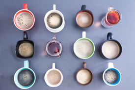 picture of brew  - Time for a coffee break or teatime with a neat line up of dfifferent mugs and glasses containing freshly brewed coffee and tea for a daily dose of caffeine to energize your day view from above - JPG