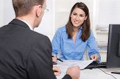 stock photo of presenter  - Business meeting at bank or insurance - JPG