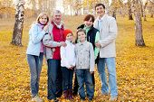 picture of grandparent child  - Families with children and grandparents in autumn park - JPG