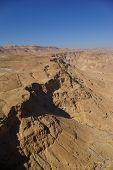 stock photo of zealots  - View on Judean desert and Roman fortification ruins from Masada fortress Israel - JPG
