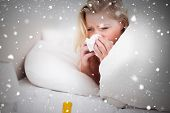 picture of blanket snow  - Composite image of blonde woman sneezing against snow falling - JPG