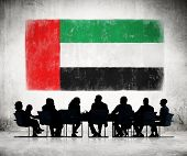 picture of emirates  - Business People in a Meeting with United Arab Emirates Flag - JPG