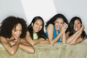 picture of comrades  - Group of young women lying on a bed looking at camera smiling - JPG