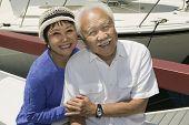 Постер, плакат: Азиатский старший пара обнимая в Марина портрет