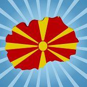 picture of macedonia  - Macedonia map flag on blue sunburst illustration - JPG