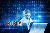 foto of binary code  - The word security and redhead businesswoman using her laptop against blue technology interface with binary code - JPG