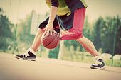 pic of mood  - Young man on basketball court dribbling with ball - JPG