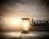 stock photo of hourglass figure  - Conceptual image with huge sandglass - JPG