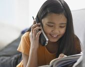 stock photo of pre-adolescent girl  - Young girl talking on phone - JPG
