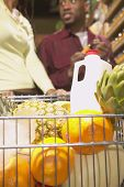 stock photo of grocery cart  - Shopping cart with groceries - JPG