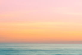stock photo of atlantic ocean  - Abstract subset sky and ocean nature background with blurred panning motion - JPG