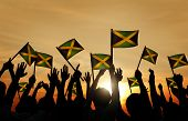 picture of jamaican flag  - Group People Waving Flag Jamaica Back Lit Concept - JPG
