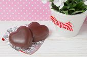 stock photo of valentine candy  - two chocolate candy hearts on a wooden background valentines day - JPG