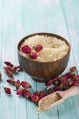 picture of salt-bowl  - Spa setting with sea salt and flowers on aqua painted wooden boards - JPG
