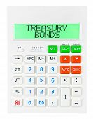 picture of treasury  - Calculator with TREASURY BONDS on display isolated on white background - JPG