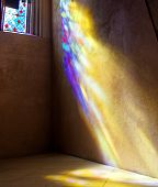 picture of stained glass  - Stained Glass window with sunrays of coloured light on wall and floor. St. Giles Cathedral. Edinburgh. Scotland. UK.