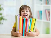 foto of little kids  - Cute kid girl preschooler with books at home - JPG