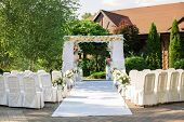 image of unity candle  - White chairs - JPG