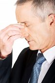 stock photo of sinuses  - Portrait of businessman suffering from sinus pain - JPG