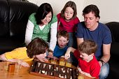 pic of boardgame  - Big family is playing a boardgame in the livingroom - JPG