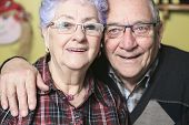 pic of retirement age  - A Portrait of a happy senior couple at home - JPG