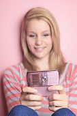 stock photo of underage  - Teenage girl use cellphone in her room.