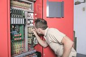 pic of adjustable-spanner  - machinist worker technicians at work adjusting lift with spanners in elevator hoistway - JPG