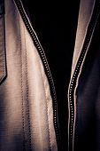 image of zipper  - Open Jacket Zipper Pull Detail Textured Textile - JPG