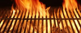 picture of braai  - Burning Hot Fire in a Barbecue with an Empty Grill - JPG