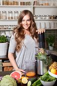 pic of juicer  - Beautiful happy woman making healthy juice with juicer - JPG