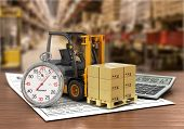 picture of forklift  - Forklift truck with boxes and stopwatch on the storage - JPG