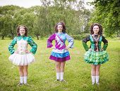 pic of wig  - Three young beautiful girls in irish dance dress and wig posing outdoor
