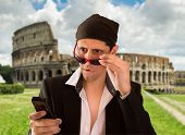 image of illegal  - latin lover doing a little illegal web browsing with cellphone in rome - JPG