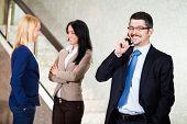 stock photo of people talking phone  - Business people in lobby - JPG