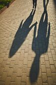 stock photo of amor  - Shadows of amorous dates walking down trottoire - JPG