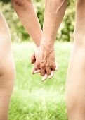 foto of nude couple  - Naked young couple walking hand in hand in nature - JPG