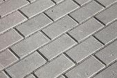 stock photo of paving stone  - foto gray paving stones on the sidewalk - JPG