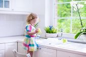 Постер, плакат: Little Girl Washing Dishes
