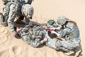 picture of medevac  - United States paratroopers airborne infantrymen in the desert rescuing their brother - JPG