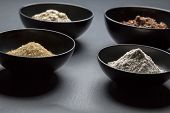 foto of black-cock  - some black bowls with baking or cocking ingredients - JPG