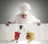 stock photo of ironic  - Vegan chef looks at a ironic billboard - JPG