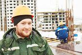 stock photo of concrete  - concrete worker - JPG