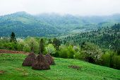 stock photo of haystack  - Mountain landscape - JPG