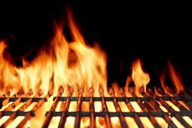 stock photo of braai  - Hot Empty Charcoal BBQ Grill With Bright Flames On The Black Background - JPG
