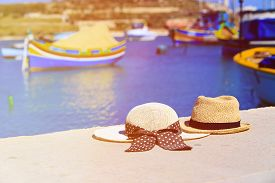 picture of maltese  - two hats with traditional maltese boats on background - JPG