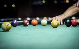picture of pool ball  - Billiard balls in a green pool table