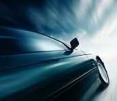 stock photo of car-window  - Blurred car and blue sky with clouds - JPG
