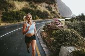 Fitness Woman Running On Highway poster