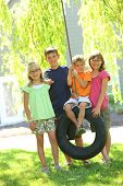 image of tire swing  - Portrait of group of children - JPG