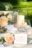foto of wedding table decor  - Place setting and card on a table at a wedding reception - JPG